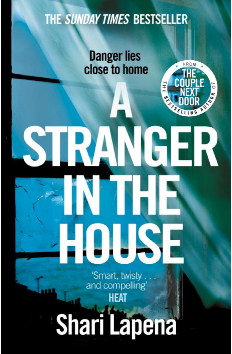 A Stranger in the House: From the author of THE COUPLE NEXT DOOR (format de buzunar)